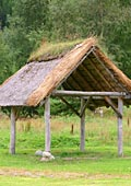 open outbuilding with thatched (straw) roof
